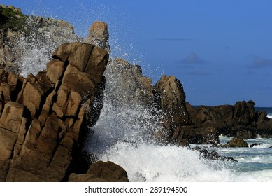 Cliffs of Doniños beach in Ferrol, A Coruña, Galicia, Spain, waves crashing on rocks with strange shapes, erosion by the sea, wind and salt, famous beach for its lagoon and its legend,
