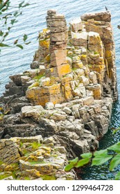 Cliffs by the Baltic Sea on the beautiful island of Bornholm, Denmark, where inventions are warmer due to its geology that accumulates calories in summer