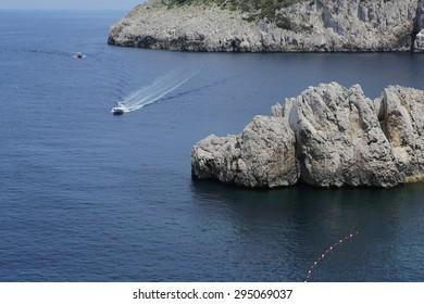 cliffs of Capri island, in summertime, Capri, Italy