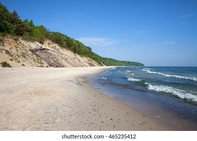 Cliffs in Chlapowo (near Wladyslawowo) along sandy beach by the Baltic Sea in Pomerania region of Poland