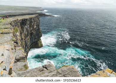 Cliffs and the famous Worm Hole, a natural pool in Inishmore, Aran islands, Ireland