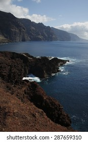 Cliffs of the Giants from Punta de Teno, on the Canary Island of Tenerife, giant moles of volcanic rock ending in the Atlantic Ocean, from blue waters are common whale sightings, sea,land,eruption,