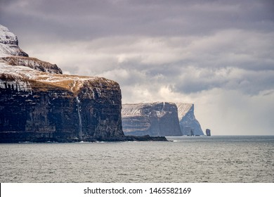 Cliffs, headlands and the sea stacks Risin og Kellingin on the north coast of Eysturoy, the second largest of the Faroe Islands in the North Atlantic.