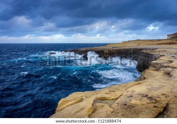 Cliffs in Island of Gozo (Żebbug) view on Reqqa Point and Salt Pans. Windy day, winter, Malta.