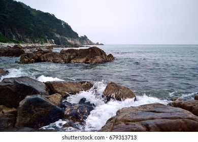 Cliffs, Islands, rocks, fog. Gamov Peninsula. Primorye. Russia.