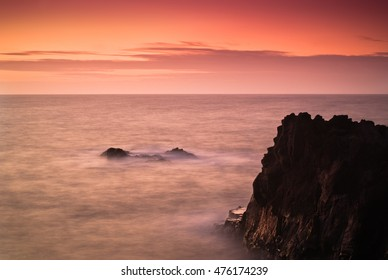 Cliffs of Los Hervideros in the oncoming waves on a long exposure. Lanzarote. Canary Islands. Spain