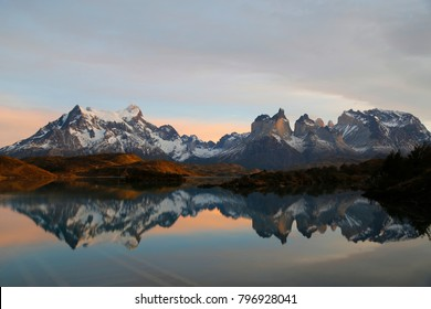 Cliffs of Los Kuernos reflection during sunrise at Lake Pehoe in National Park Torres del Paine, Patagonia, Chile