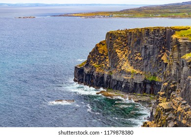 Cliffs of Moher with Doolin village and farm fields in background, Clare, Ireland