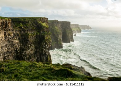 The Cliffs of Moher, Irelands Most Visited Natural Tourist Attraction, are sea cliffs located at the southwestern edge of the Burren region in County Clare, Ireland.