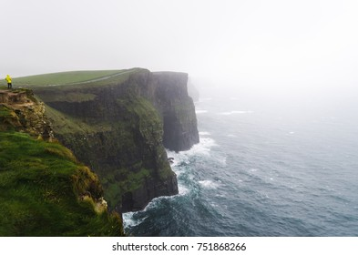 Cliffs of Moher on a gray, rainy and cloudy day located in Liscannor, Ireland