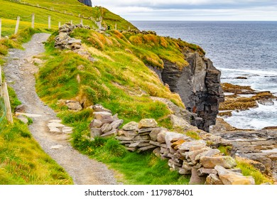 Cliffs of Moher trail with rocks and ocean, Doolin, Clare, Ireland