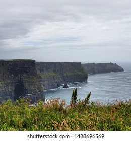 The Cliffs of Moher under a grey sky