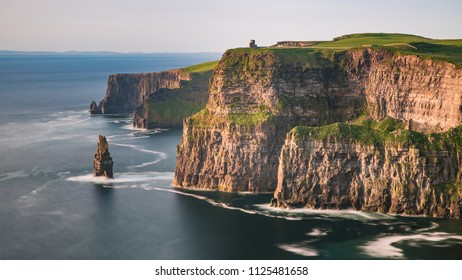 Cliffs of Moher, West Ireland, Atlantic coast at sunset. The Cliffs of Moher are sea cliffs located at the southwestern edge of the Burren region in County Clare, Ireland.