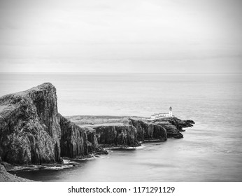 Cliffs of Neist Point Cape and lighthouse in black and white. Popular travelers destination on Isle of Skye,  Scotland.