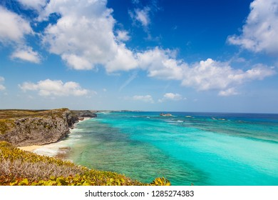 Cliffs, reef and turquoise shallows at Mudjin Harbor, Middle Caicos