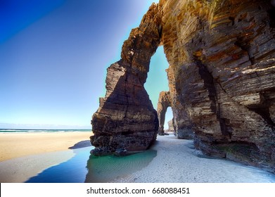 Cliffs and rocks during low tide in Cathedrals Beach in northern Spain.