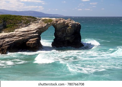 Cliffs, rocks and low tide with tourist in Cathedrals Beach in Galicia, Spain; on april 28, 2017 in Ribadeo.