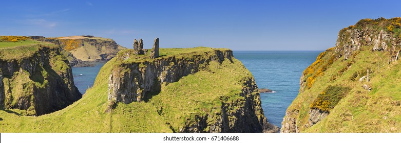 Cliffs with the ruins of Dunseverick Castle along the Causeway Coastal Way on the coast of Northern Ireland. Photographed on a bright and sunny day.