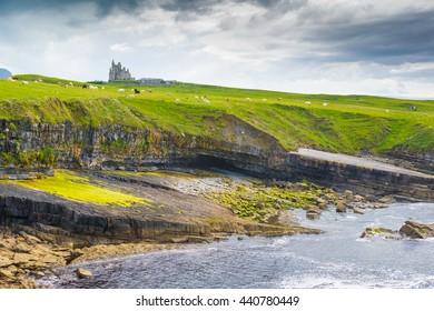 Cliffs, sea and castle in Mullaghmore in Sligo, Ireland