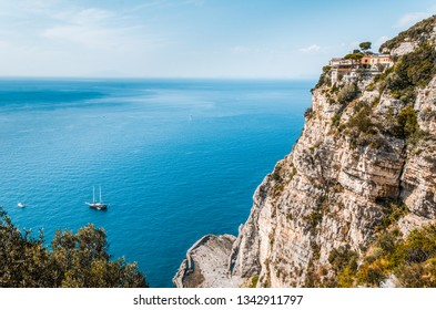 Cliffs of Sorrento Italy with blue skys and sail boats in the bay