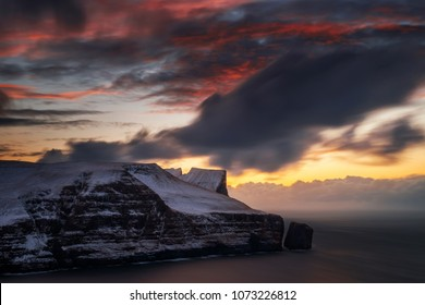 Cliffs of Stakkur Streymoy Island in red sunset light, Faroe Islands