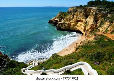 Cliffs, surf and beach at Praia do paraiso carvoerio Algarve Portugal
