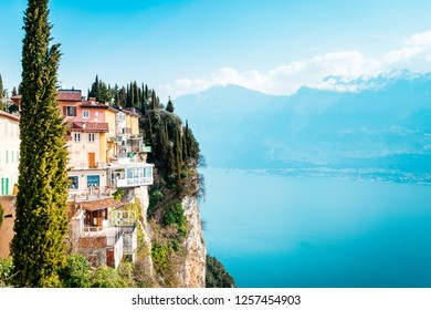 The cliffs of Tremosine sul Garda, view to the balconies at the cliffs next to the abyss, in the background Lake Garda, Italy