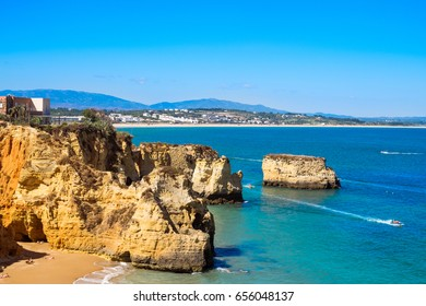 Cliffside view of Lagos, Portugal in the late afternoon