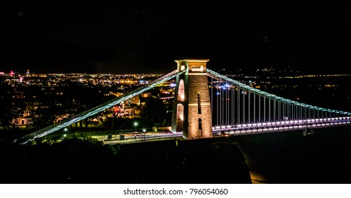 Clifton Suspension Bridge is a famous landmark for the city of Bristol, England. Photo taken in 2016 on fireworks night, some of which can be seen in the background.
