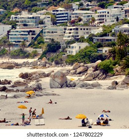Clifton, an upmarket beach suburb of Cape Town and popular tourist attraction. White beaches and apartments on hillside. Cape Town, South Africa, Western Cape. December 2018