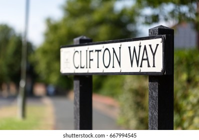 Clifton Way, street name sign in Woking, Surrey, England. Low angle close up crop
