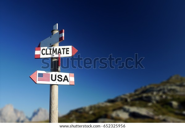 Climate change and American flag in two directions on road sign. Climatic agreement and environmental responsibility concept.