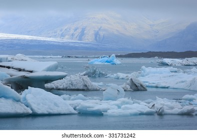 Climate change: blue iceberg in the distance in the Jokulsarlon lagoon on Iceland.