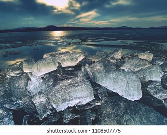 Climate change. Detail of glacier melting  in bay. Spring landscape with melting of ice floe.