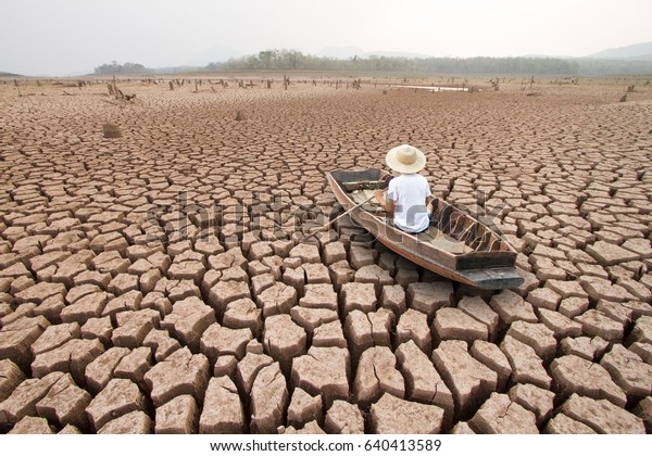 Climate change, The man on wood boat at large drought land