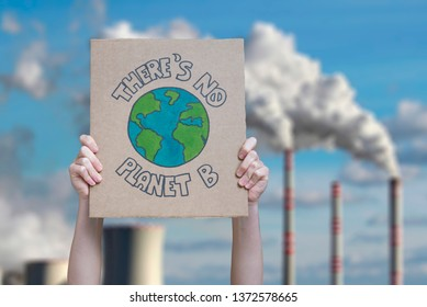 Climate change manifestation poster on an industrial fossil fuel burning