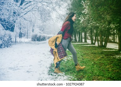 climate change. winter change to spring. woman undressing when saw that spring is came