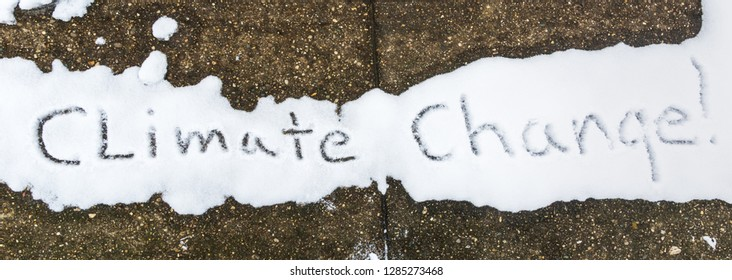 Climate change Written in melting snow on an old sidewalk in the dead of winter  Kentucky January 2019 concept photography