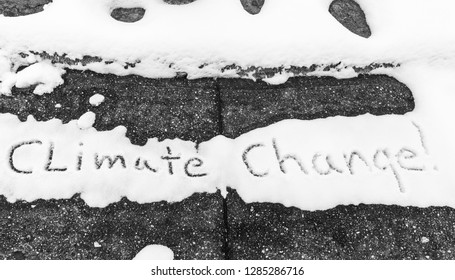 Climate change Written in melting snow on an old sidewalk in the dead of winter  Kentucky January 2019 concept black and white photography