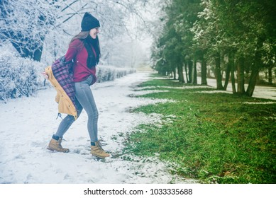 climate changing concept. Woman undressing when see that spring is coming