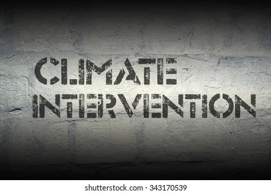 climate intervention stencil print on the grunge white brick wall