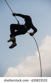 climb with rope in firefighter training
