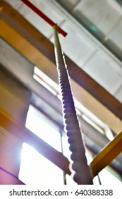 climb rope in gym interior, close up