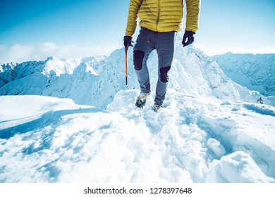 A climber ascending a mountain in winter