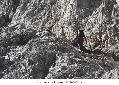 Climber ascending the via ferrata in the Dolomites