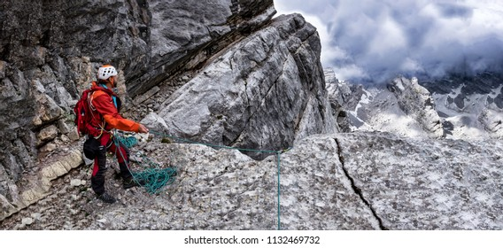 Climber Belay in the Alps whith an great view