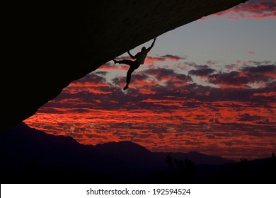 Climber in blood red sky