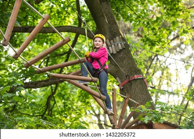 Climber child on training. Happy child boy calling while climbing high tree and ropes. Climber child on training. Artworks depict games at eco resort which includes flying fox or spider net