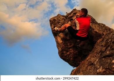 climber climbing on rock.  Strong male climber with copy space