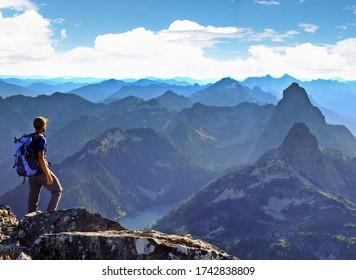 A Climber Enjoys Mountain Views Near Soqualmie Pass. The Alpine Lakes Wilderness, Washington